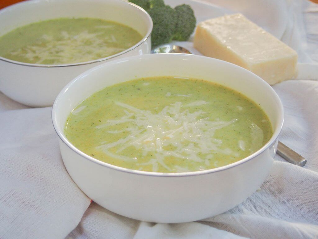 Pumpkin broccoli soup with cheddar in bowl