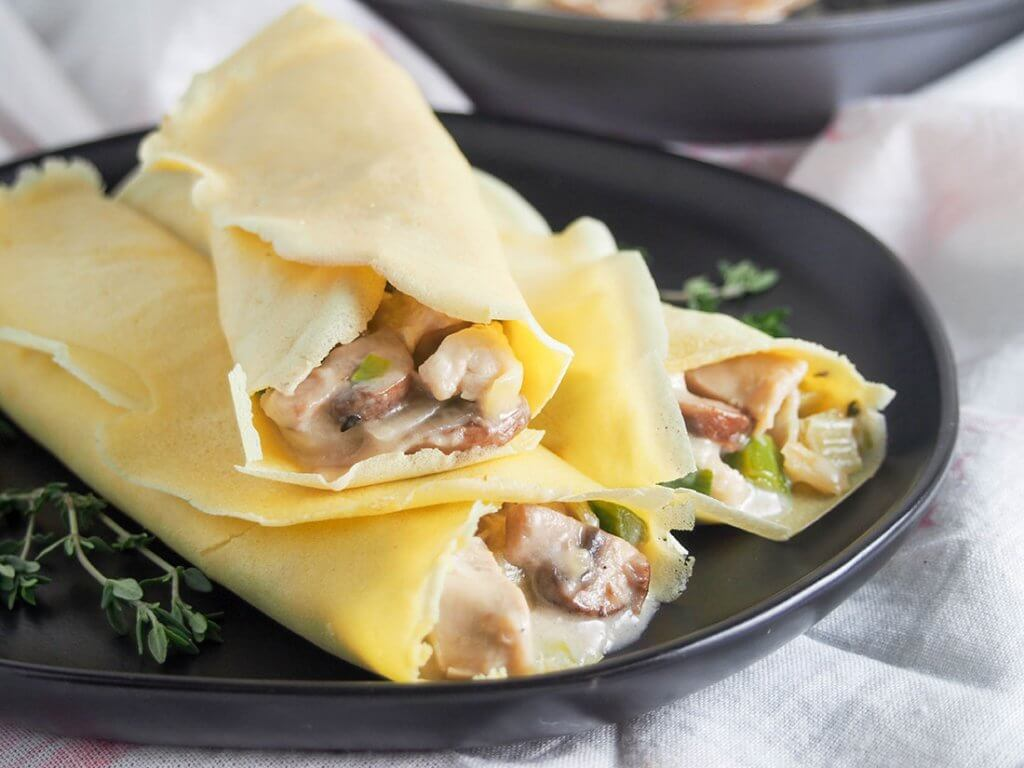 Chicken crepes with leek and mushroom on plate