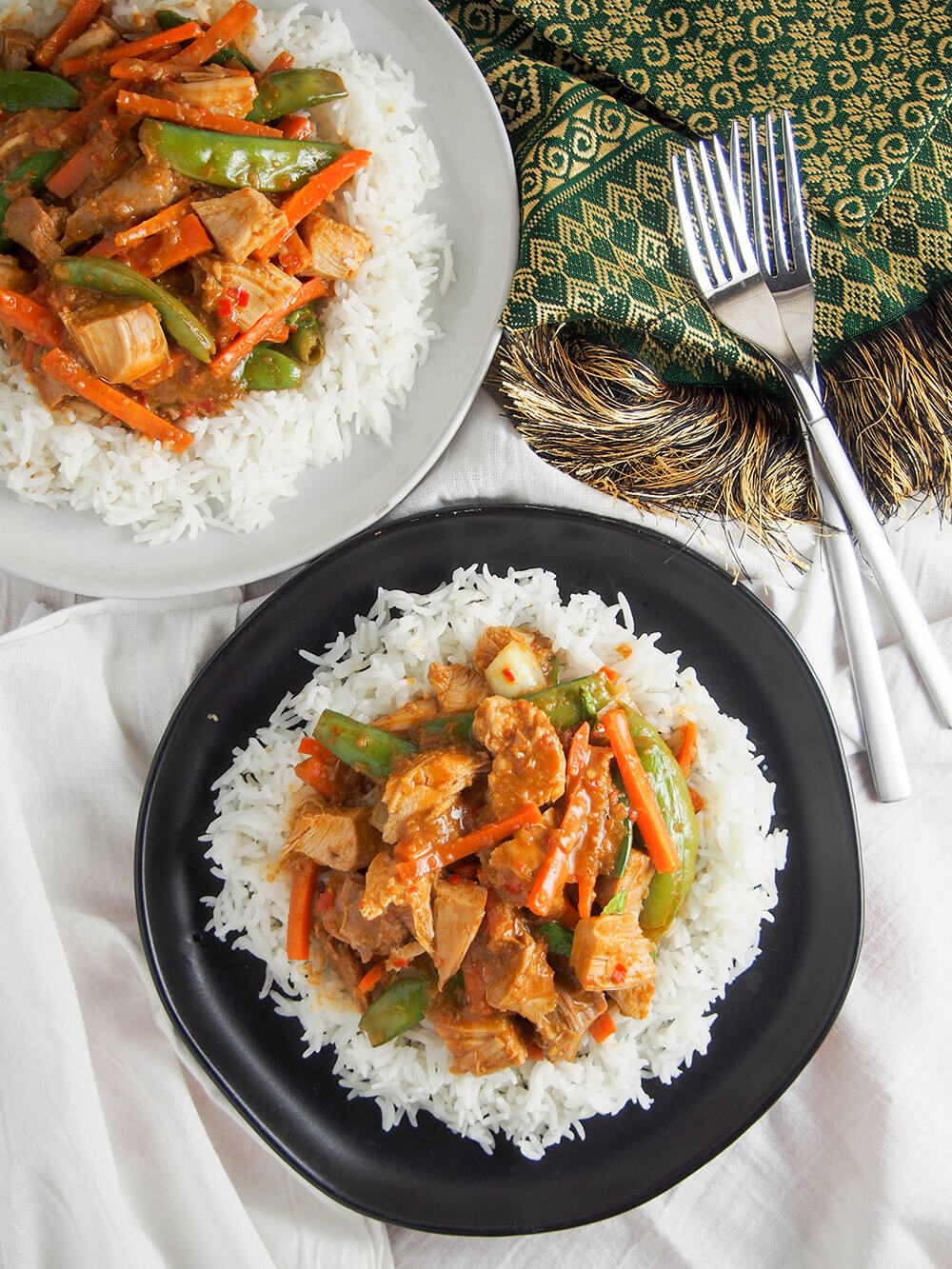 Thai red curry using leftovers showing two plates from overhead