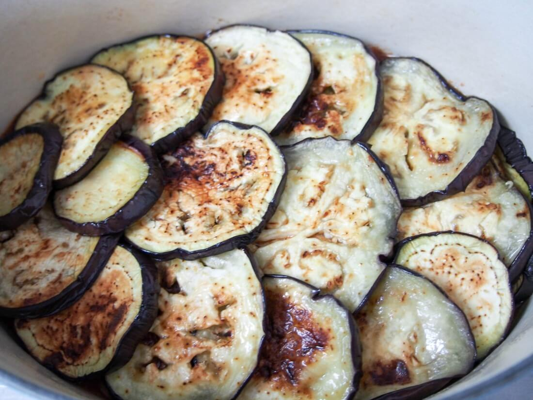 making moussaka - layering eggplant