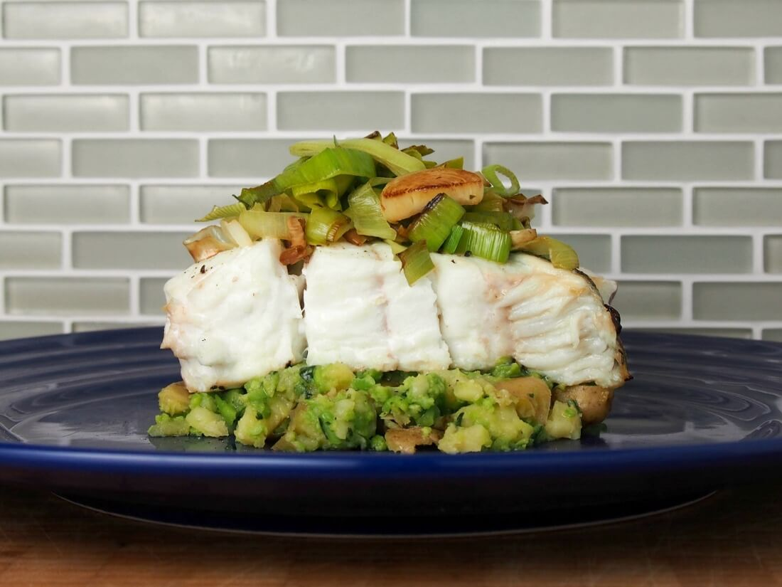 Halibut with pea-basil smashed potatoes and fried leeks