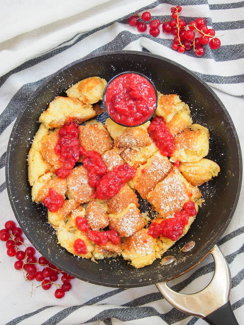 Kaiserschmarrn (Austrian torn pancakes) from above with compote drizzled over