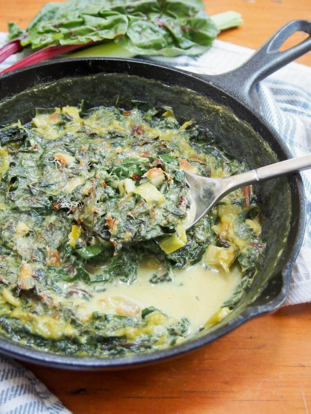 Leek and Swiss chard gratin with spoonful taken from it