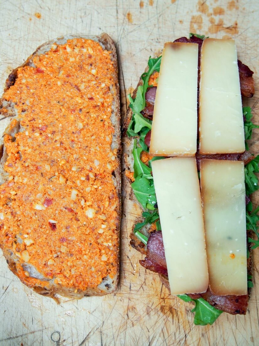 making romesco and bacon grilled cheese
