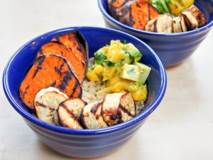 Cuban quinoa bowl with grilled sweet potato and plantain and avocado-mango salsa