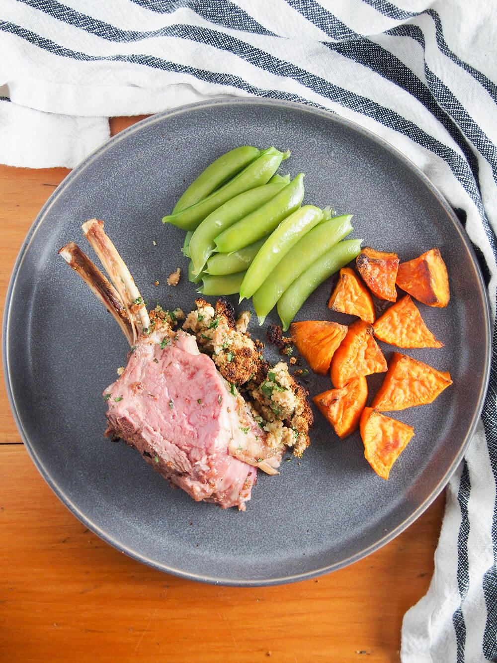 Garlic herb crusted rack of lamb on plate