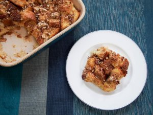 This overnight baked banana French toast is easy to make and delicious with bananas baked in and a touch of brown sugar and pecans crisped on the top.
