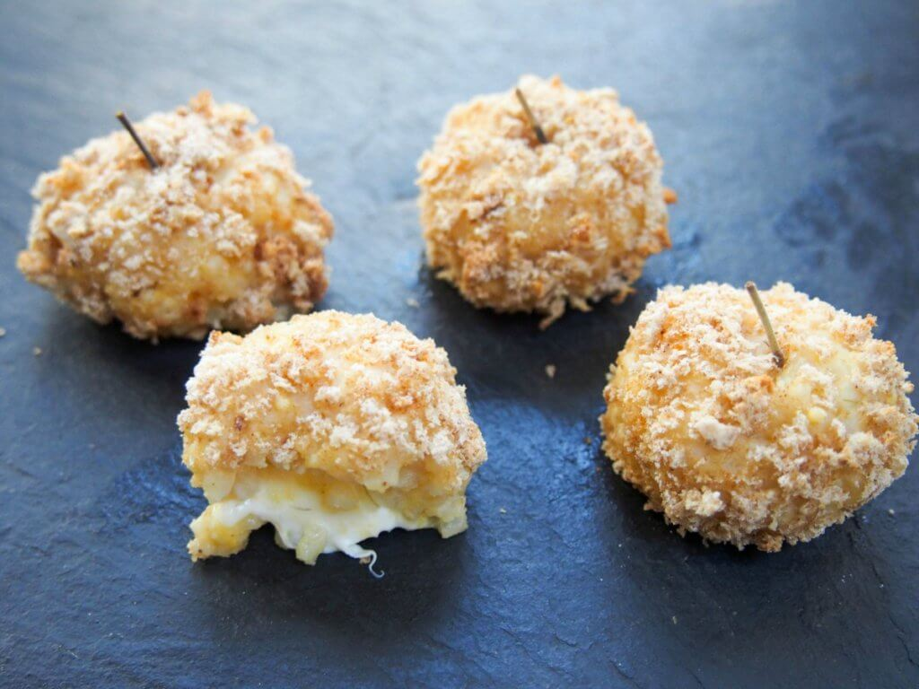 These baked pumpkin arancini are so flavorful and comforting with a gooey cheese center. A great appetizer or snack eg for a festive party or game day.