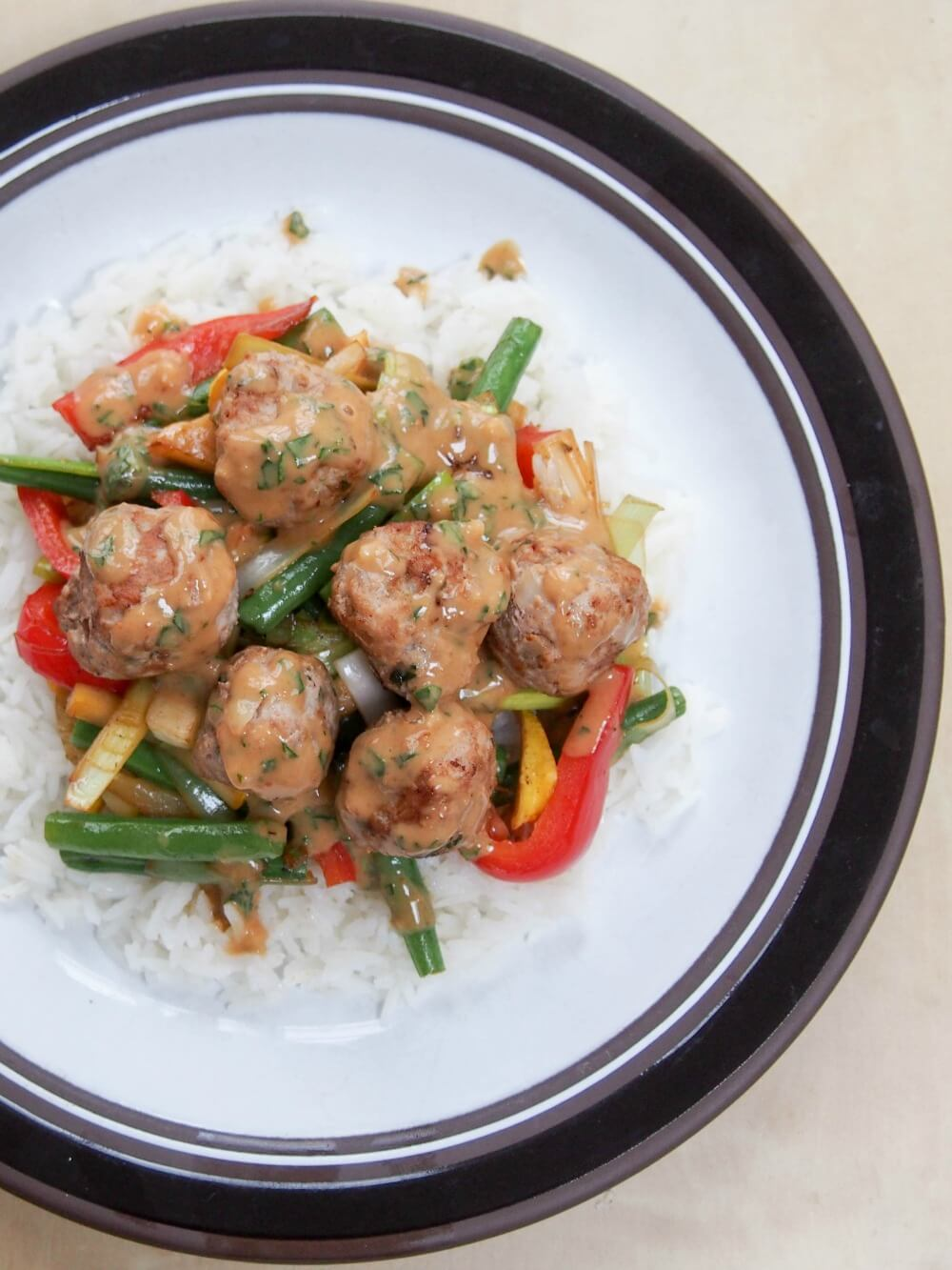 Thai basil pork meatballs with peanut-basil sauce as stir fry