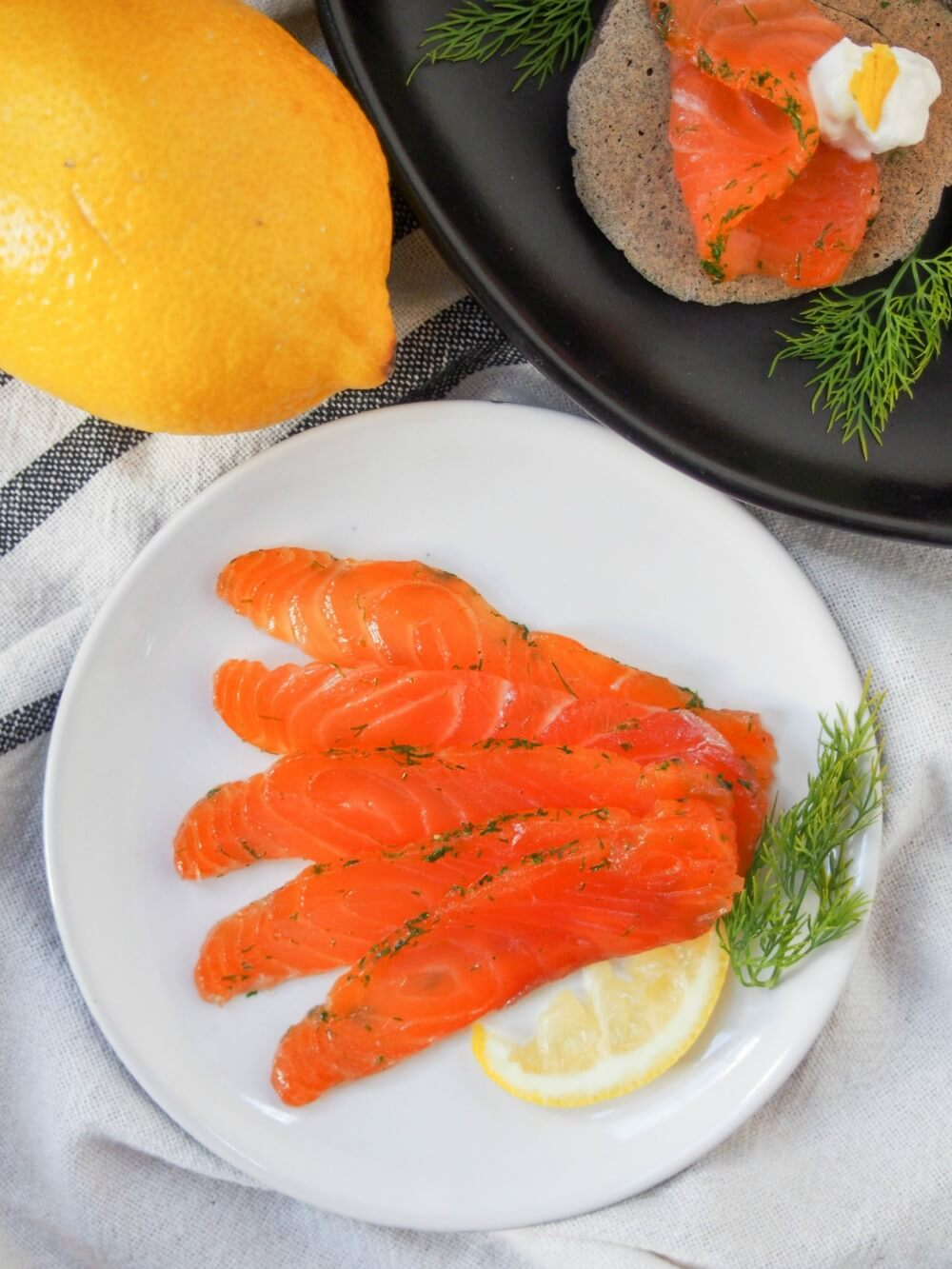 Salmon gravlax tastes similar to smoked salmon, but without the pricetag. Easy to make, all you need is a little planning, then enjoy the delicate, lightly herbed flavor of this home-cured salmon. Great as an appetizer and more.
