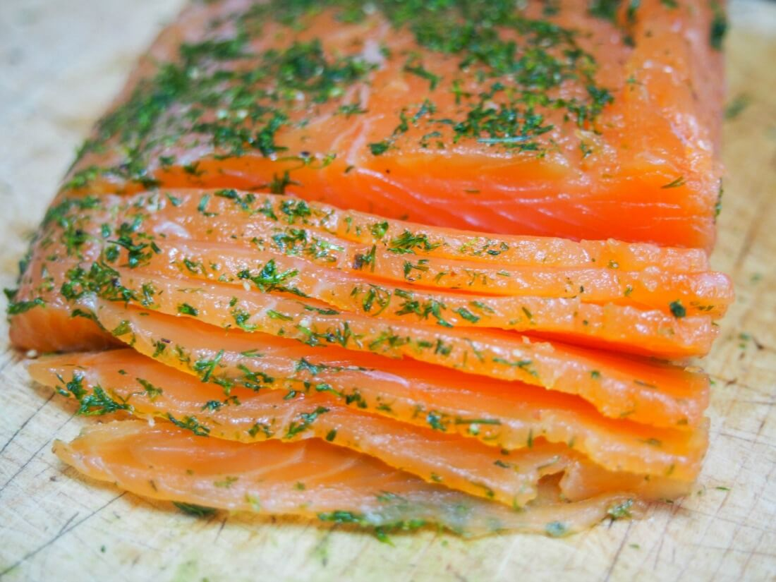 slicing salmon gravlax