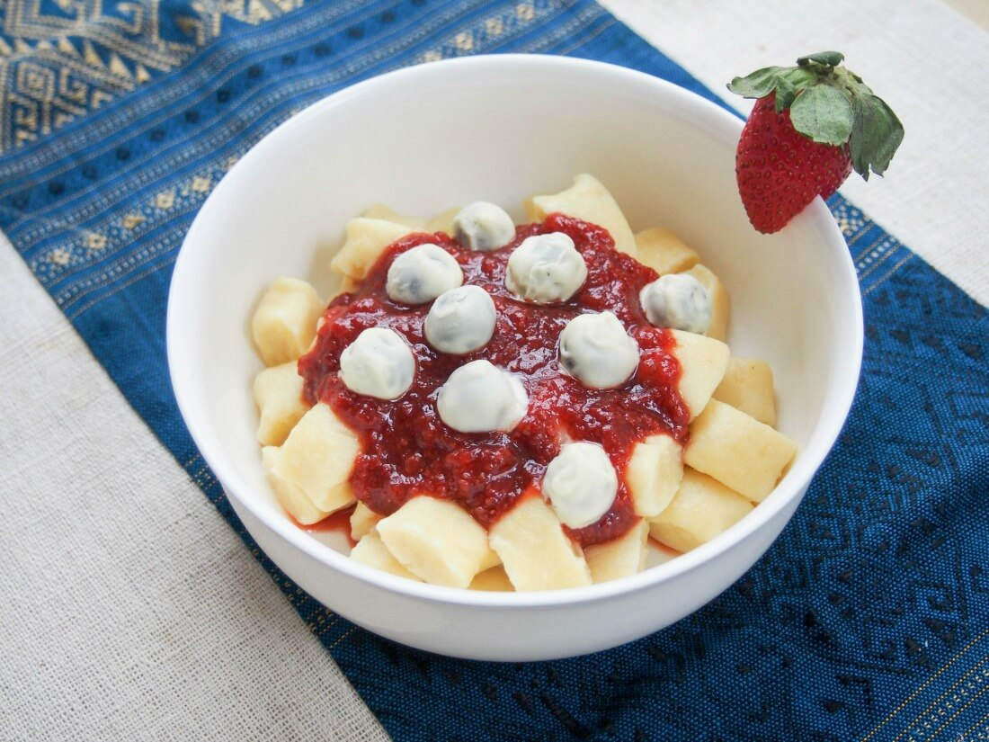 Dessert gnocchi with balsamic strawberry sauce