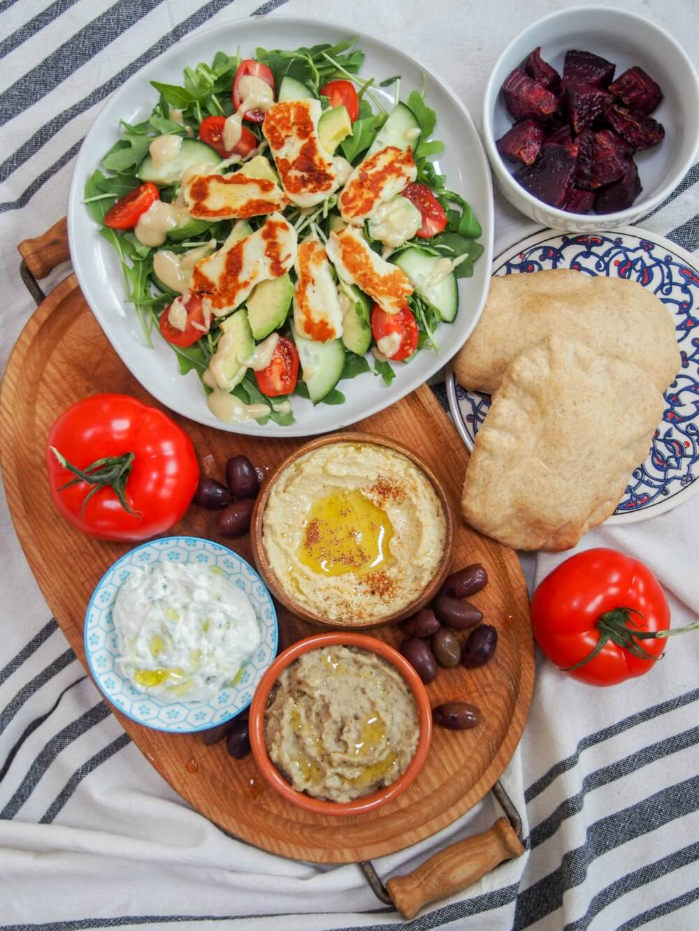baba ghanoush eggplant dip/spread (baba ganoush) along with hummus, halloumi salad and other mezze