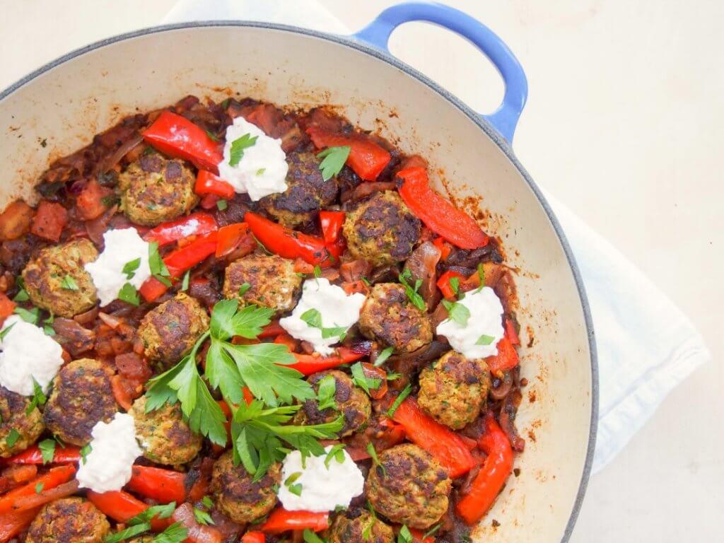 kofte style lamb meatballs in a tomato pepper sauce