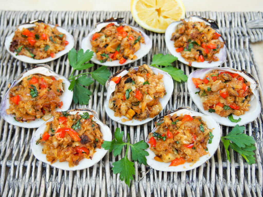 New England style stuffed clams are a delicious appetizer made with steamed clams & seasoned buttered breadcrumbs, baked until crisp on top but moist within