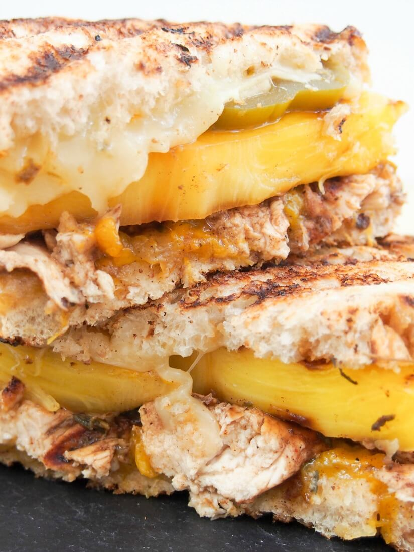 """The Jammin' Jamaican"" chicken grilled cheese: This chicken grilled cheese is a delicious sweet spicy mix of Caribbean flavors in sandwich form - a quick mango jam, spiced chicken, grilled pineapple & more. Yum!"