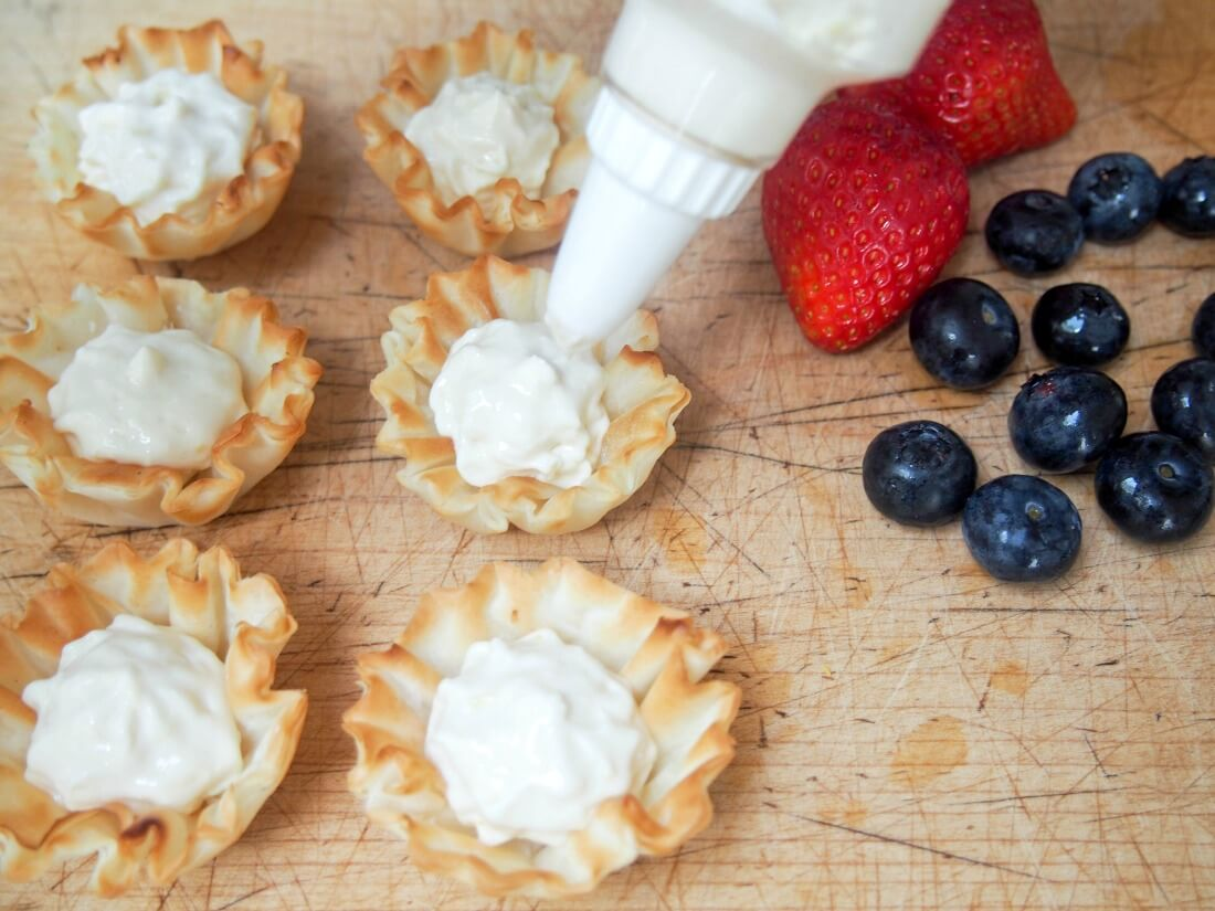 making berry phyllo cups with lemon cheesecake cream