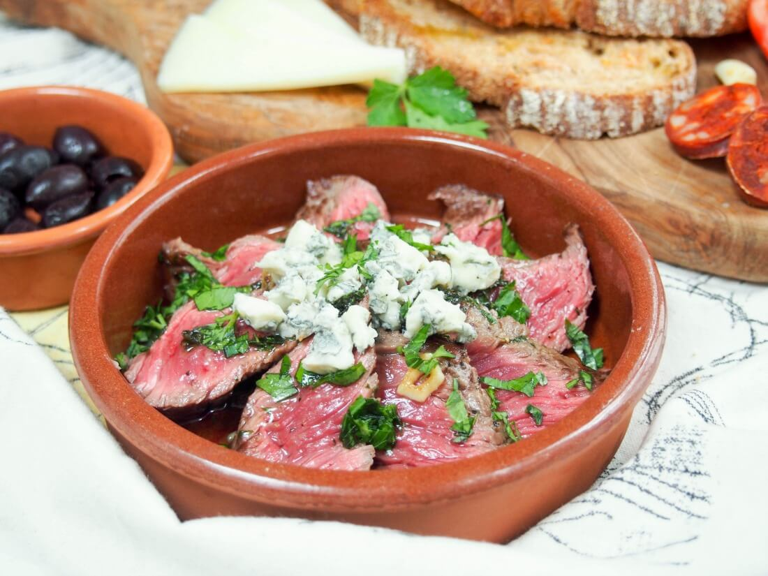 white wine marinated steak with blue cheese