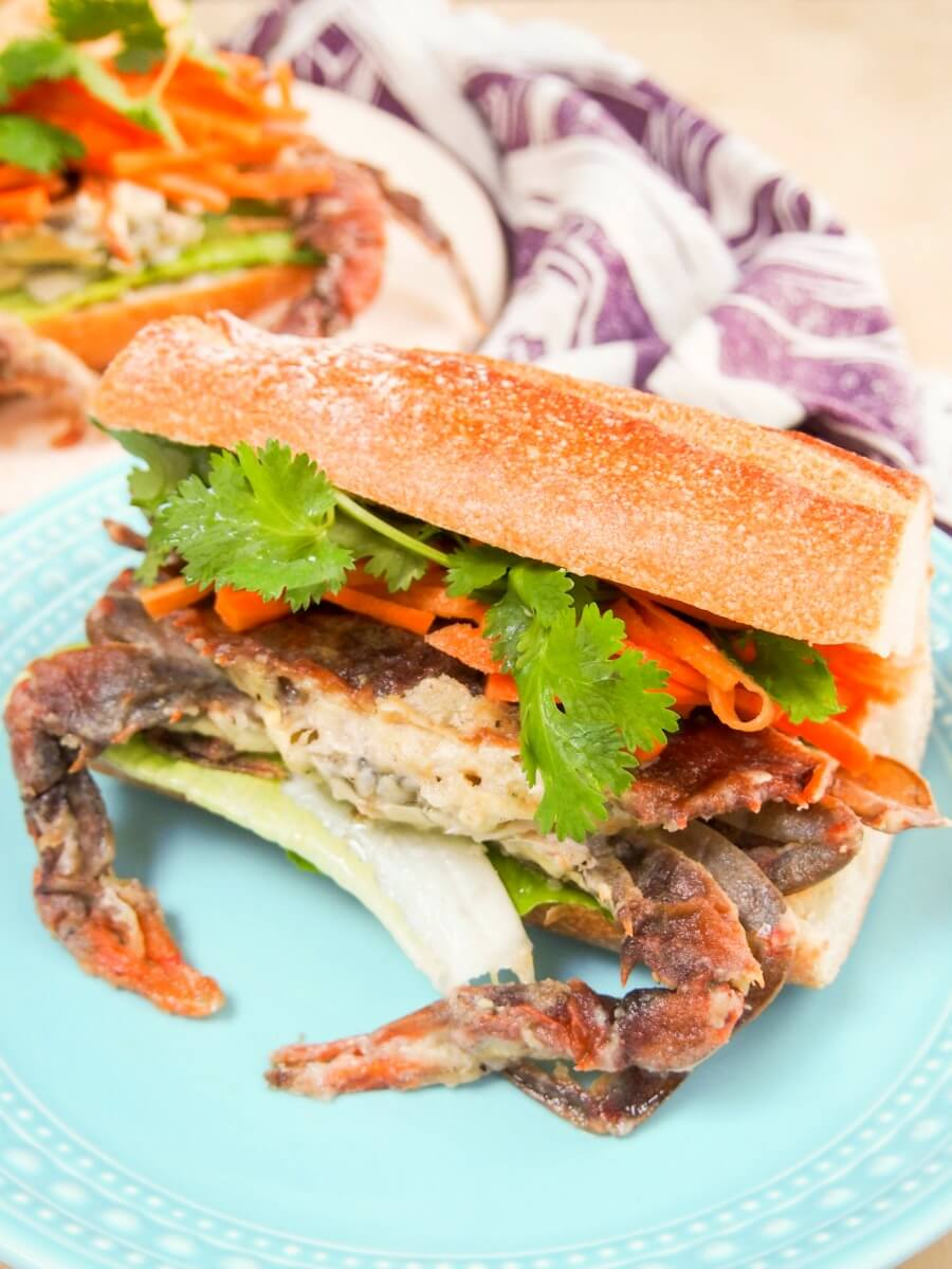 This bahn mi-style soft shell crab sandwich may be messy to eat, but it's one of the tastiest sandwiches you'll ever eat. With pickled carrots & sriracha mayo.