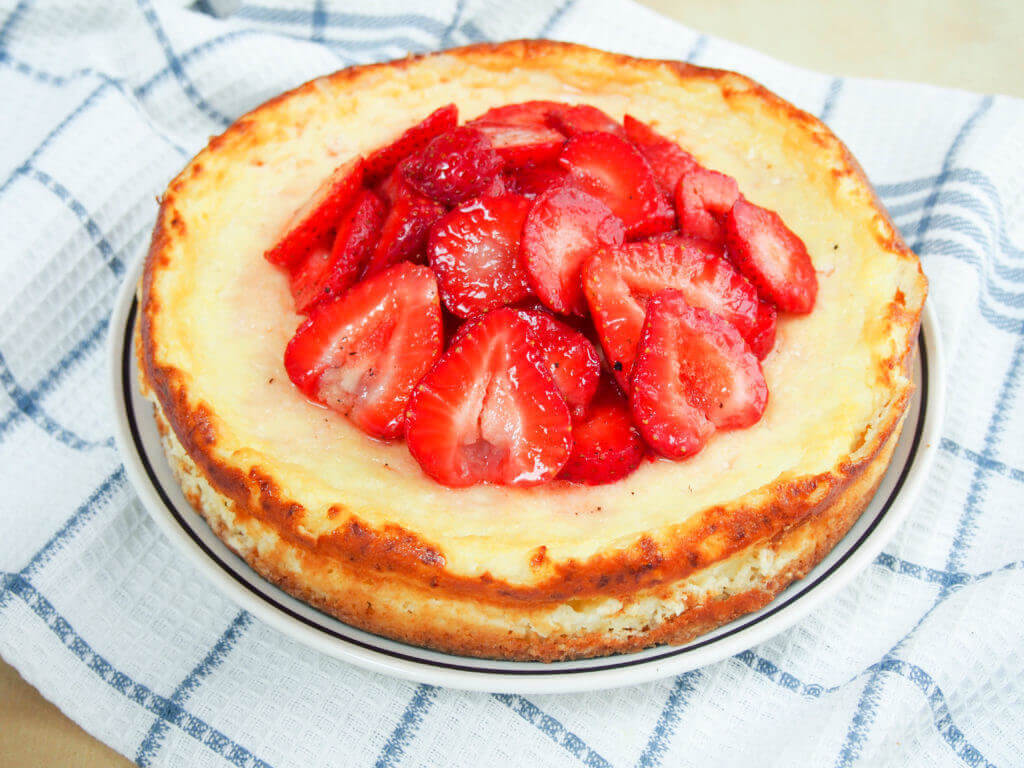 Swedish cheesecake with strawberries (ostkaka), made with cottage cheese and almonds, is not as sweet as an American cheesecake, but it's equally delicious.