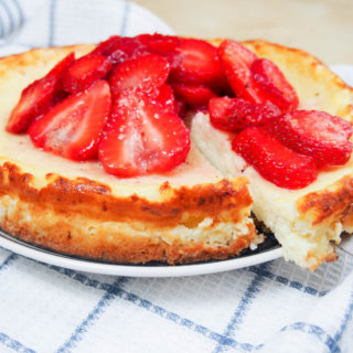 Swedish cheesecake with strawberries (ostkaka), made with cottage cheese and almonds, is not as sweet as an American cheesecake, but it's equally delicious. GF