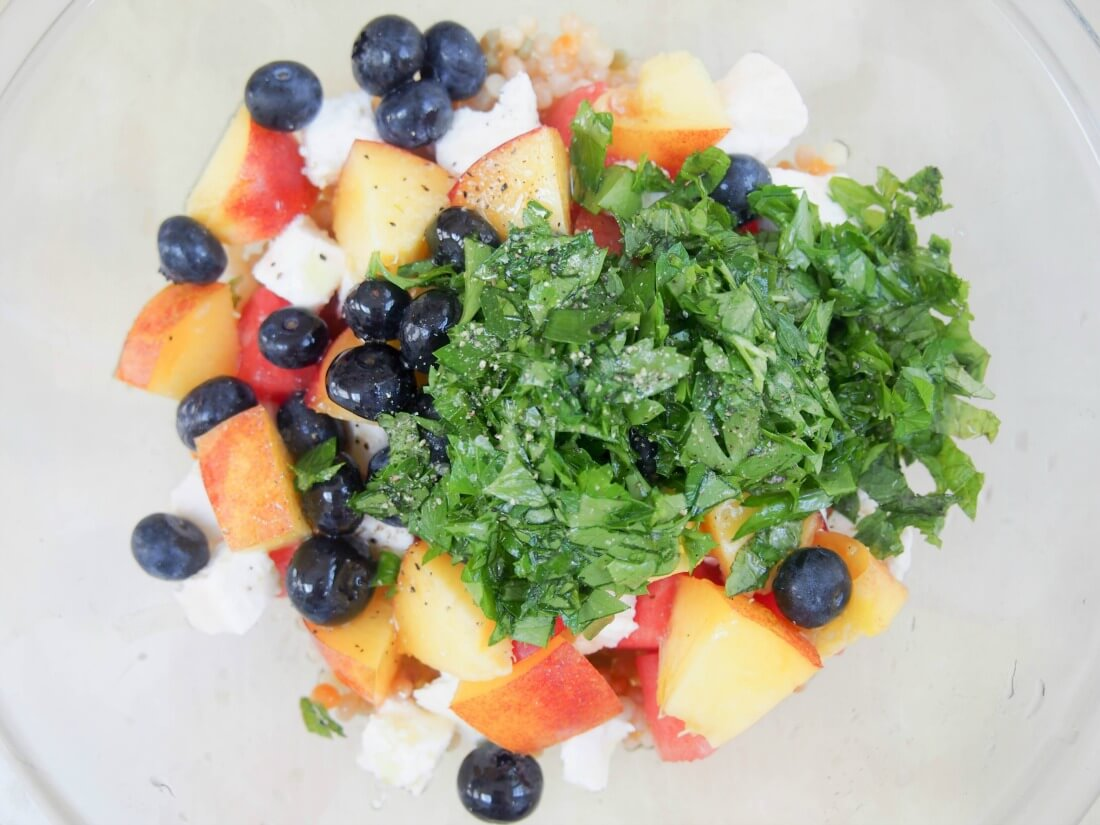 making Fruit, herb and feta Israeli couscous salad