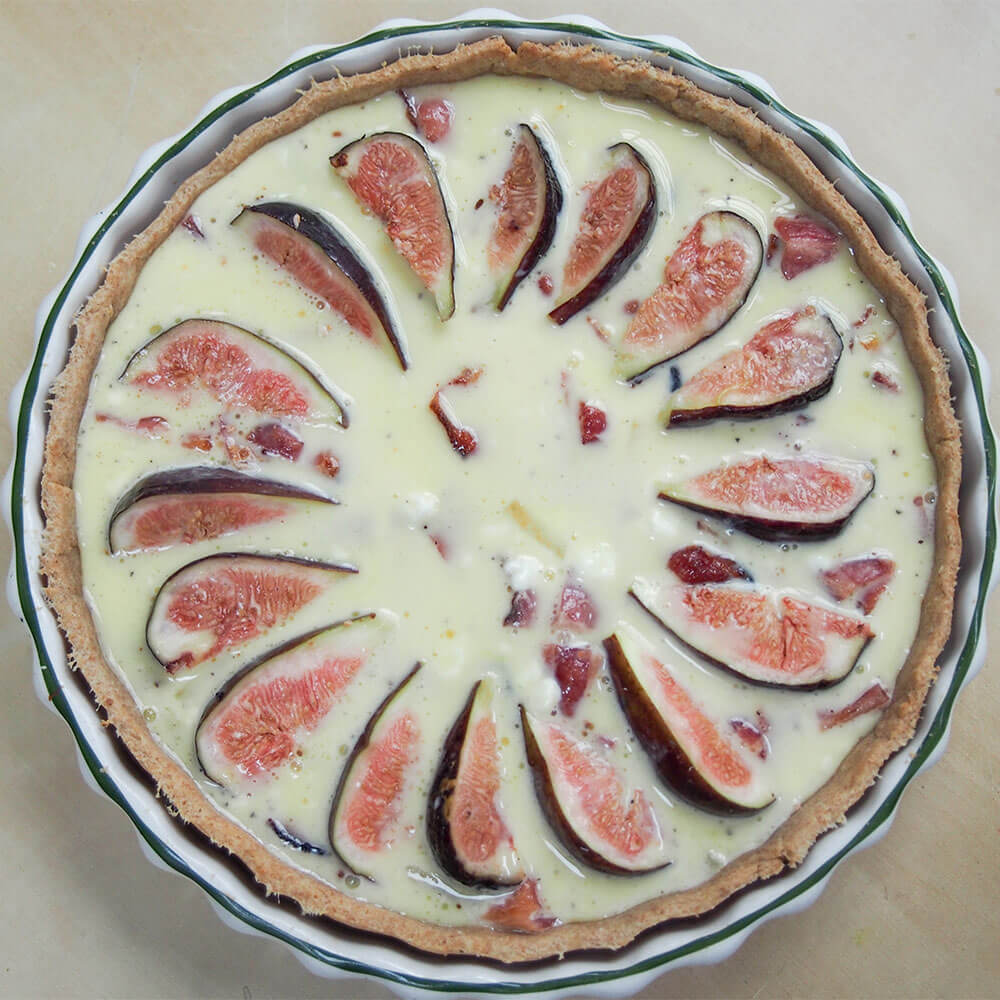 fig, goat's cheese and bacon quiche ready to bake