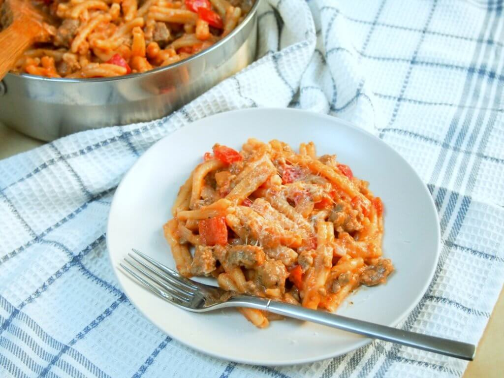 Spicy sausage pasta skillet - 1 pan + 7 ingredients = a delicious dinner. So much flavor, hearty and sure to please all, especially the cook being easy too.