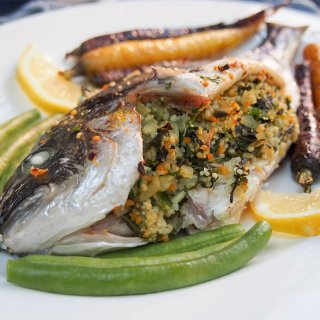 This chard couscous stuffed fish is a delicious take on baked whole fish. With a lemony undertone, this dish is flavorful and impressive looking too.