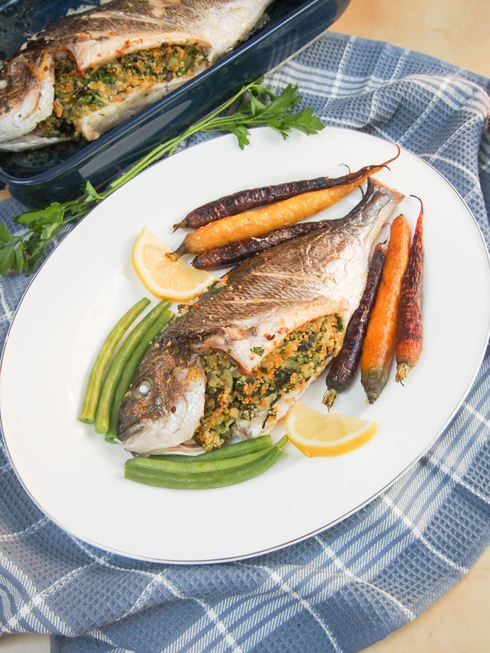 chard couscous stuffed fish on plate