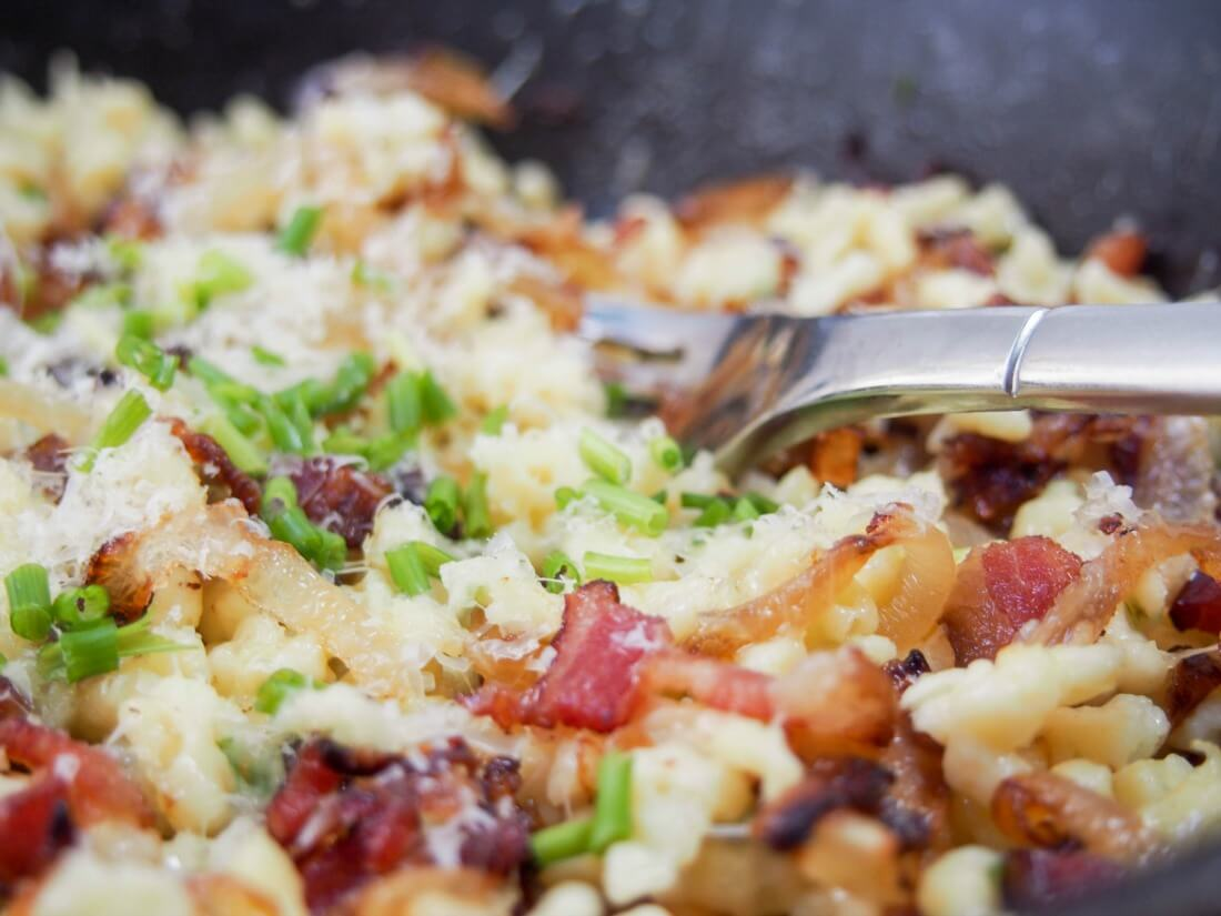 Bacon onion spaetzle in a simple but delicious combination of spaetzle/other small pasta, bacon, caramelized onions and cheese. Perfect comfort food.