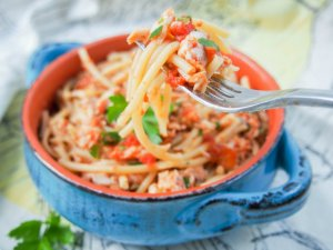 Fish ragu pasta is a tasty, simple combination of a tomato and fish-based sauce over pasta. Vary the fish for a fuller or fresher flavor, but all delicious.