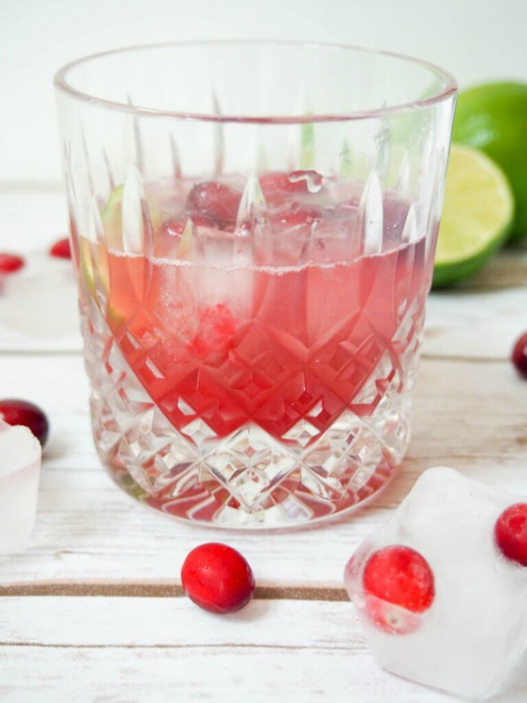 Make an already easy, delicious cocktail even more colorful and festive - this cranberry caipirinha is refreshing and the perfect drink to toast the Holidays.