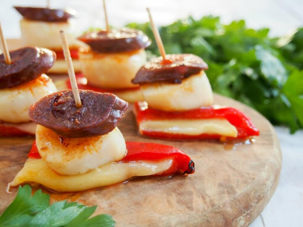 These scallop and chorizo stacks are a little taste of Spain, between the chorizo, piquillo peppers and Manchego cheese. So easy, great flavors. A delicious appetizer.