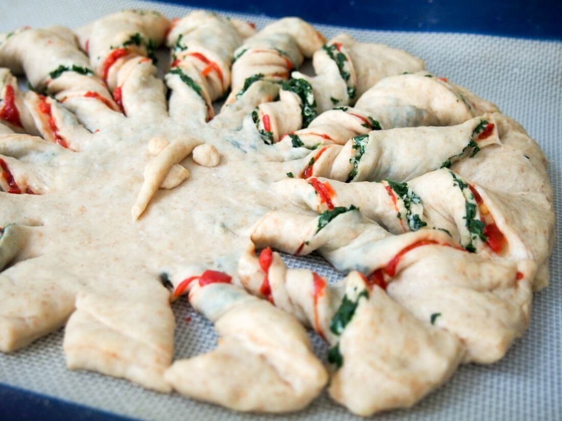 making twisted bread with peppers, spinach and parmesan