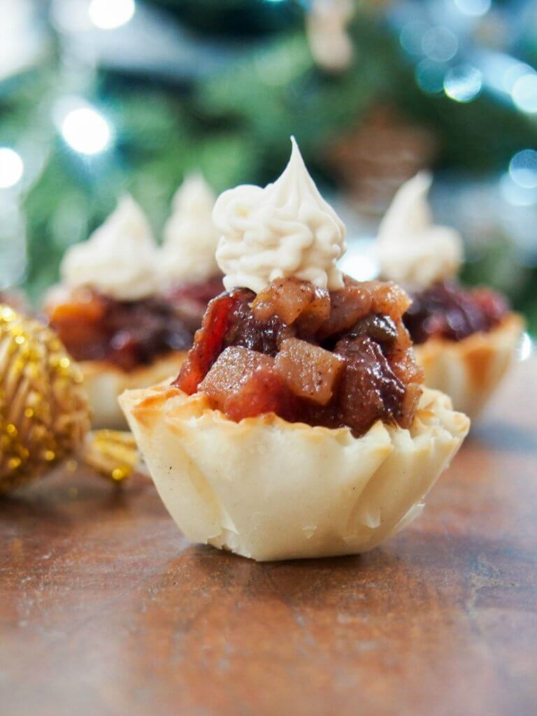 These mini mincemeat tarts are a super easy Christmas treat. Delicious, spiced fruit in crisp pastry with a creamy topping. Perfect Holiday entertaining finger food.