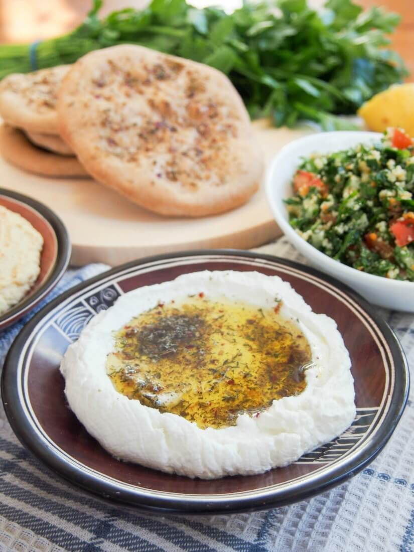 If you've tried labneh as part of a mezze meal, you might be surprised to know it's really easy to make yourself at home. Just 3 ingredients & a few min to prep to make this tasty, cream cheese popular in Israel/Jordan and the area.