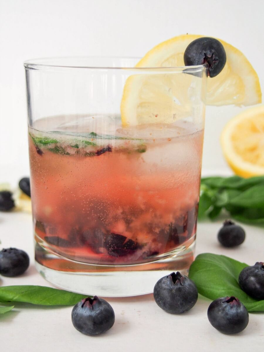 This bashful blueberry cocktail is a delicious mix of blueberries, lemon, vermouth, whiskey and a hint of basil. Topped with soda, it's a refreshing drink, perfect for summer