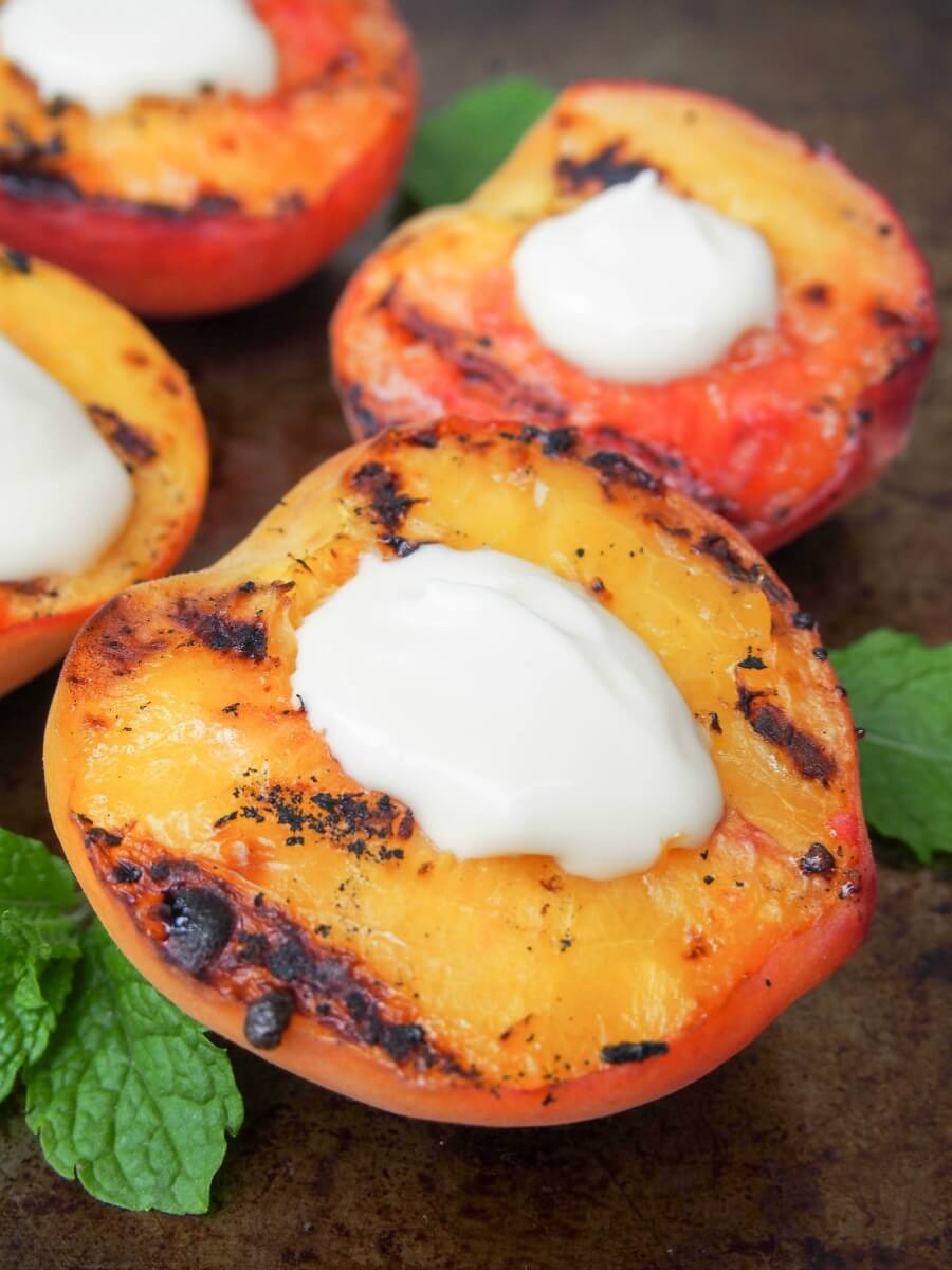 Sweet grilled peaches, with that hint of grill flavor and intensely 'peachy', topped with a smooth gently maple-sweetened mascarpone. So easy and so good.