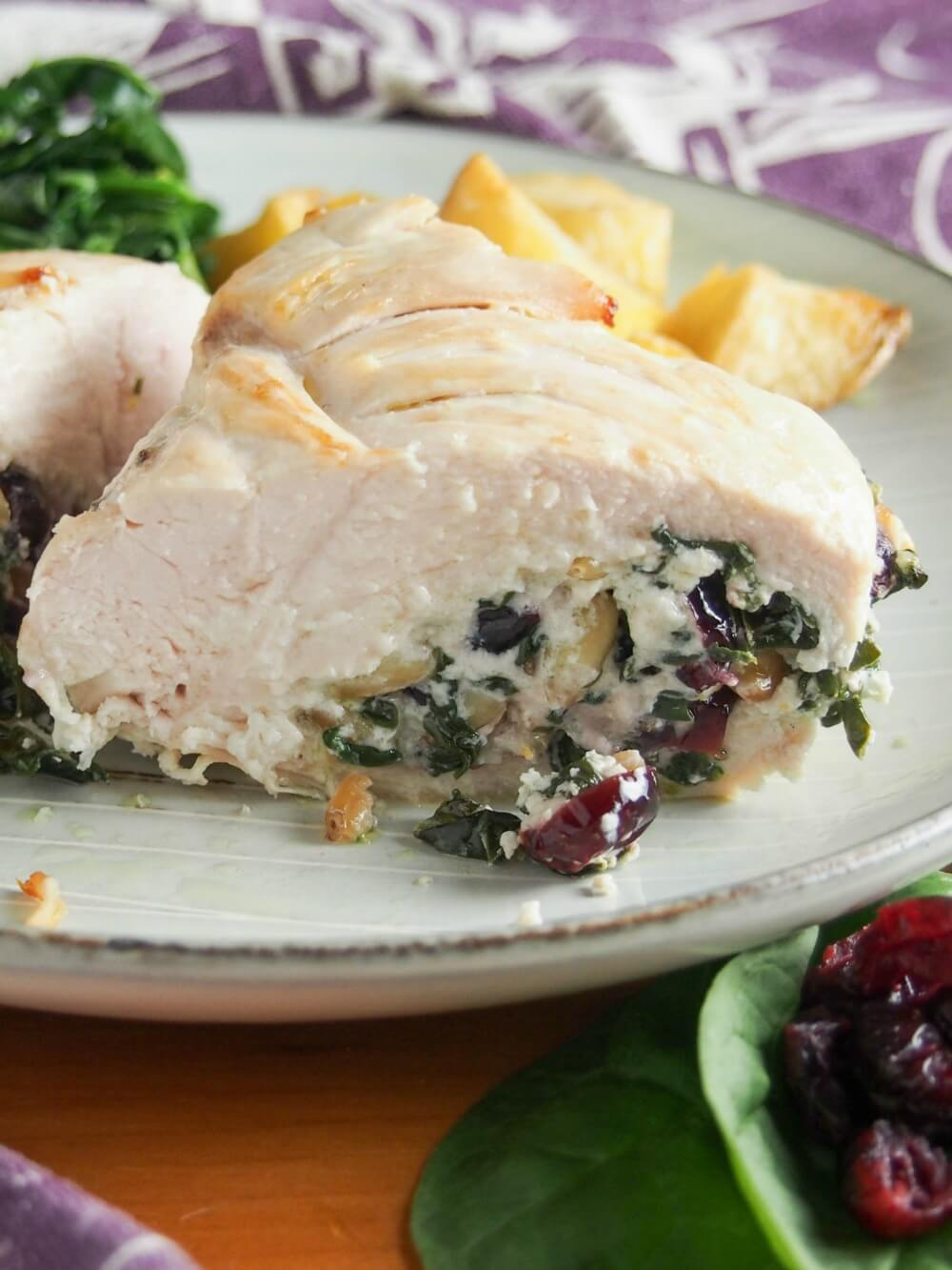 This goat cheese stuffed chicken with spinach and cranberries is deliciously comforting without being too heavy. It's fancy enough for a dinner party but quick enough for any night.
