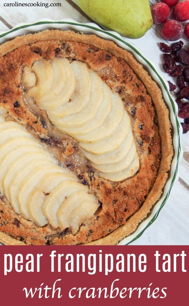 Tender pears, a soft nutty filling and crisp pastry - this pear frangipane tart with cranberries is delicious, easier than you might think and a perfectly elegant and delicious dessert for any occasion. #dessert #frangipane #tart #pear