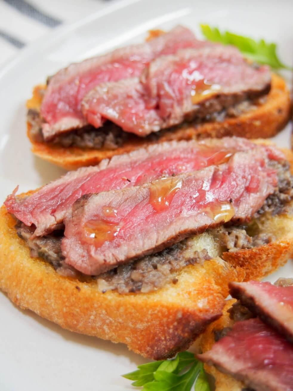 Steak crostini with mushroom pate and truffle oil - a delicious appetizer perfect for enteretaining