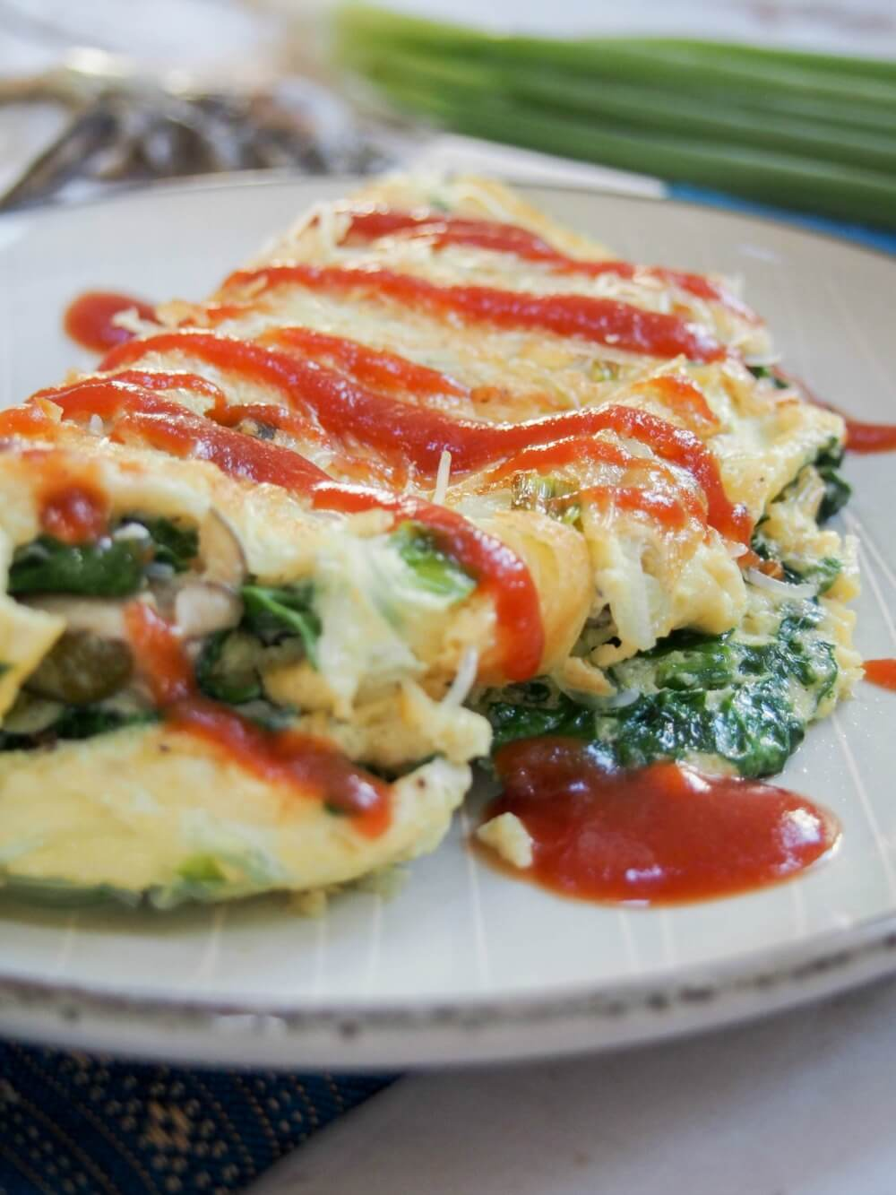 Taiwanese oyster omelette is a classic street food, but it also makes a delicious brunch/lunch - easy to make and with lots of great flavor, with oysters, greens and a flavorful sauce.