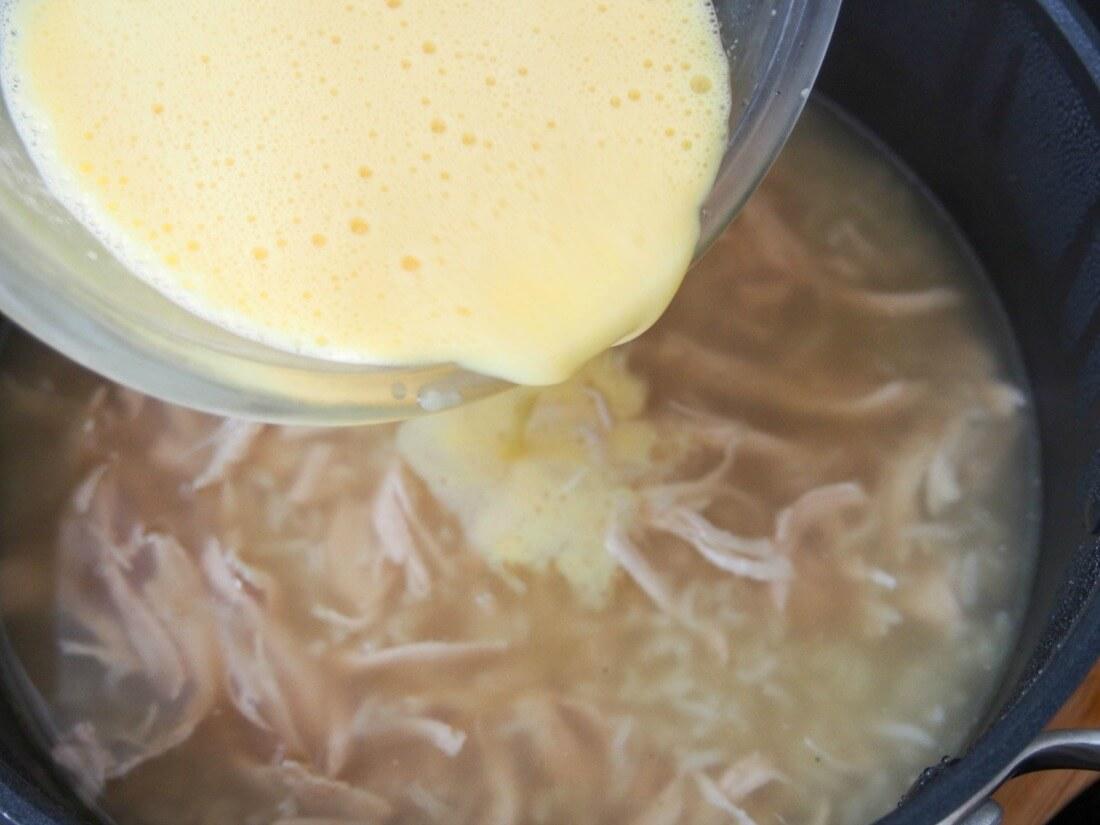 making avgolemono soup - pouring the avgolemono into the soup