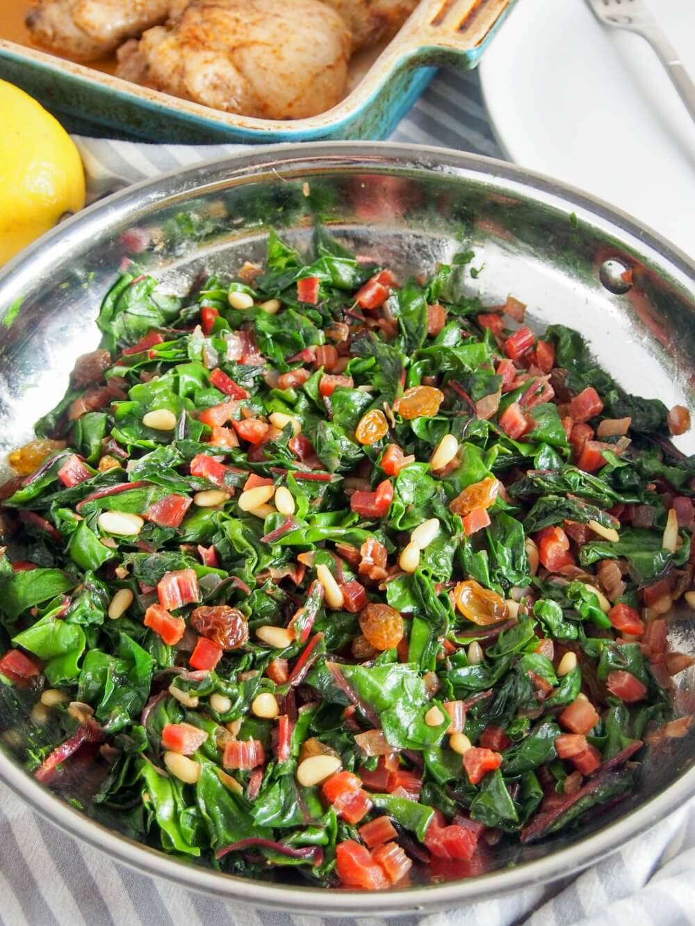 pan with Catalan-style sauteed Swiss chard with raisins and pine nuts