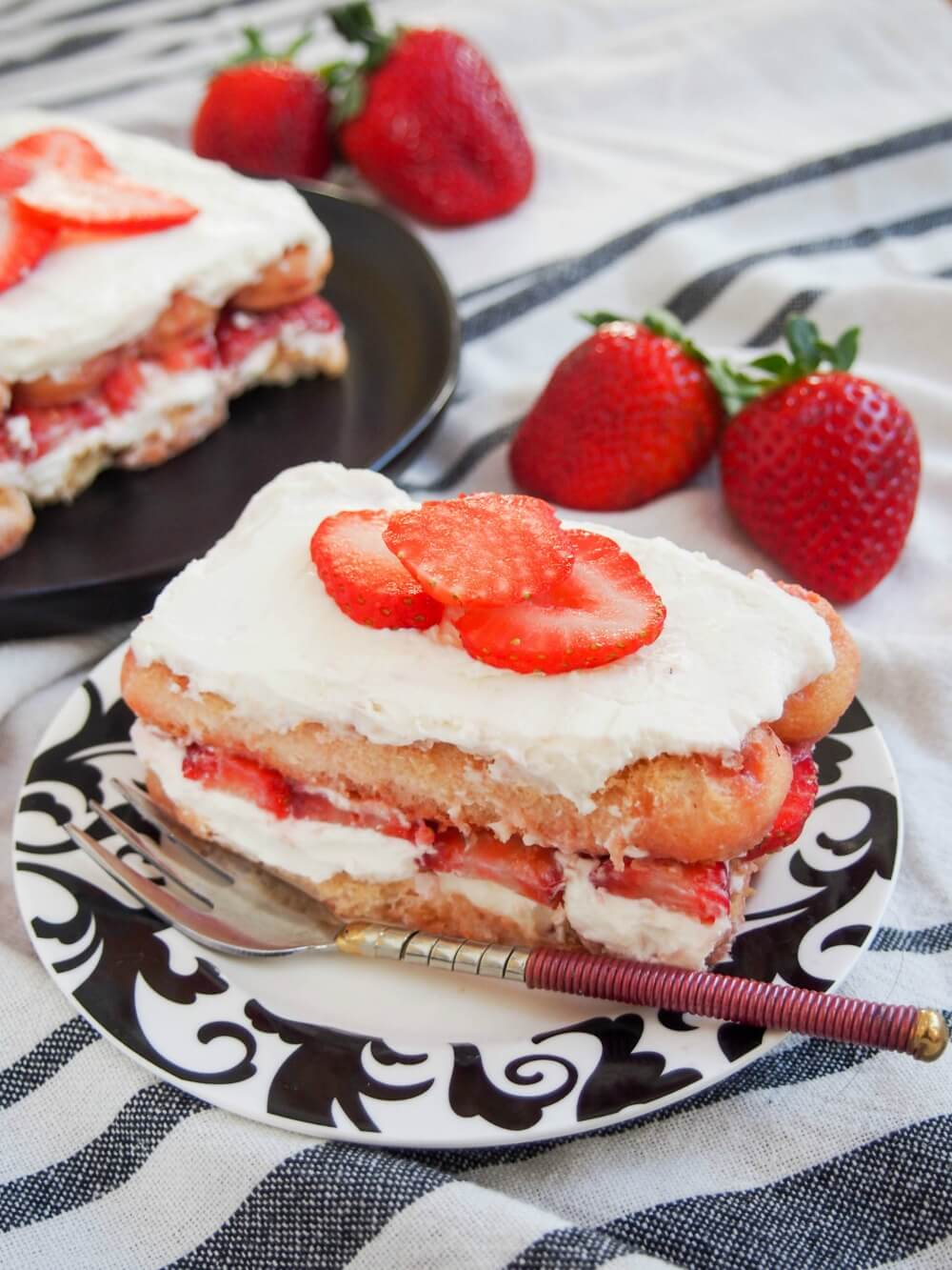 strawberry tiramisu with one serving on a plate