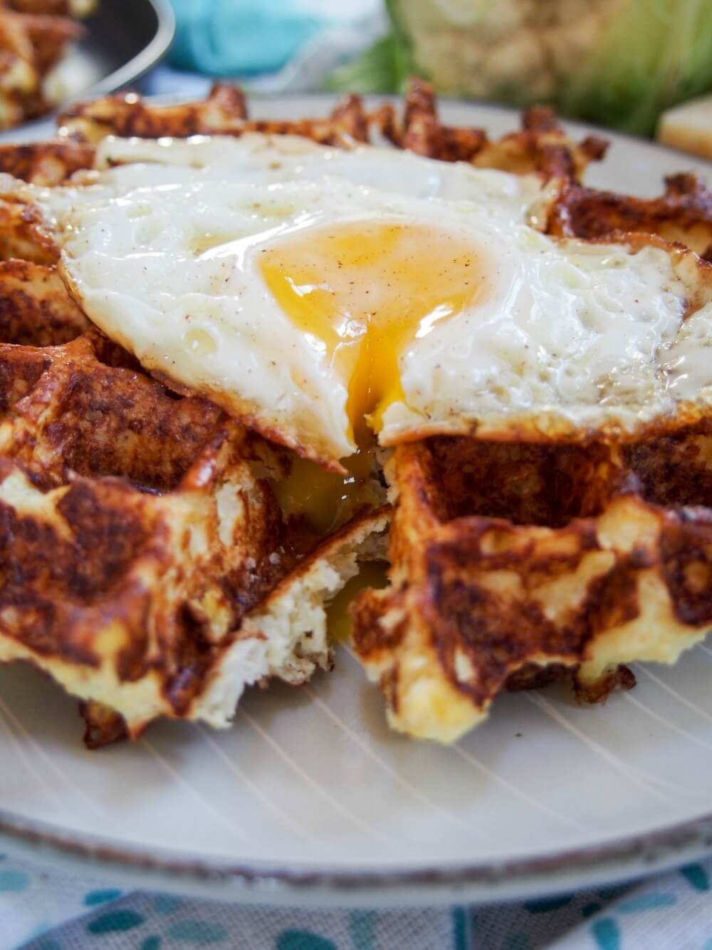 Cauliflower waffles with cut egg