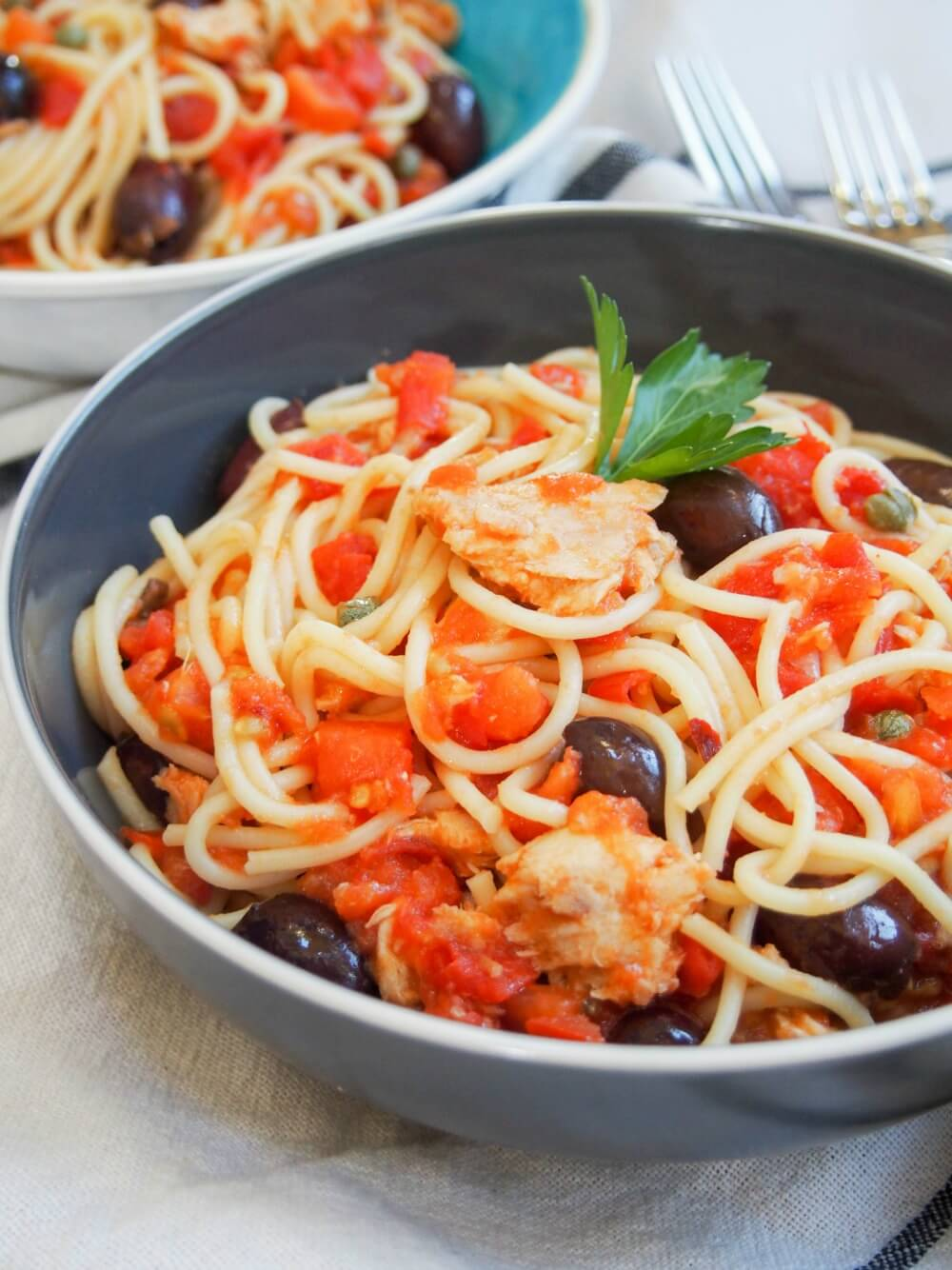 Pasta puttanesca with tomatoes, tuna, anchovies capers and olives