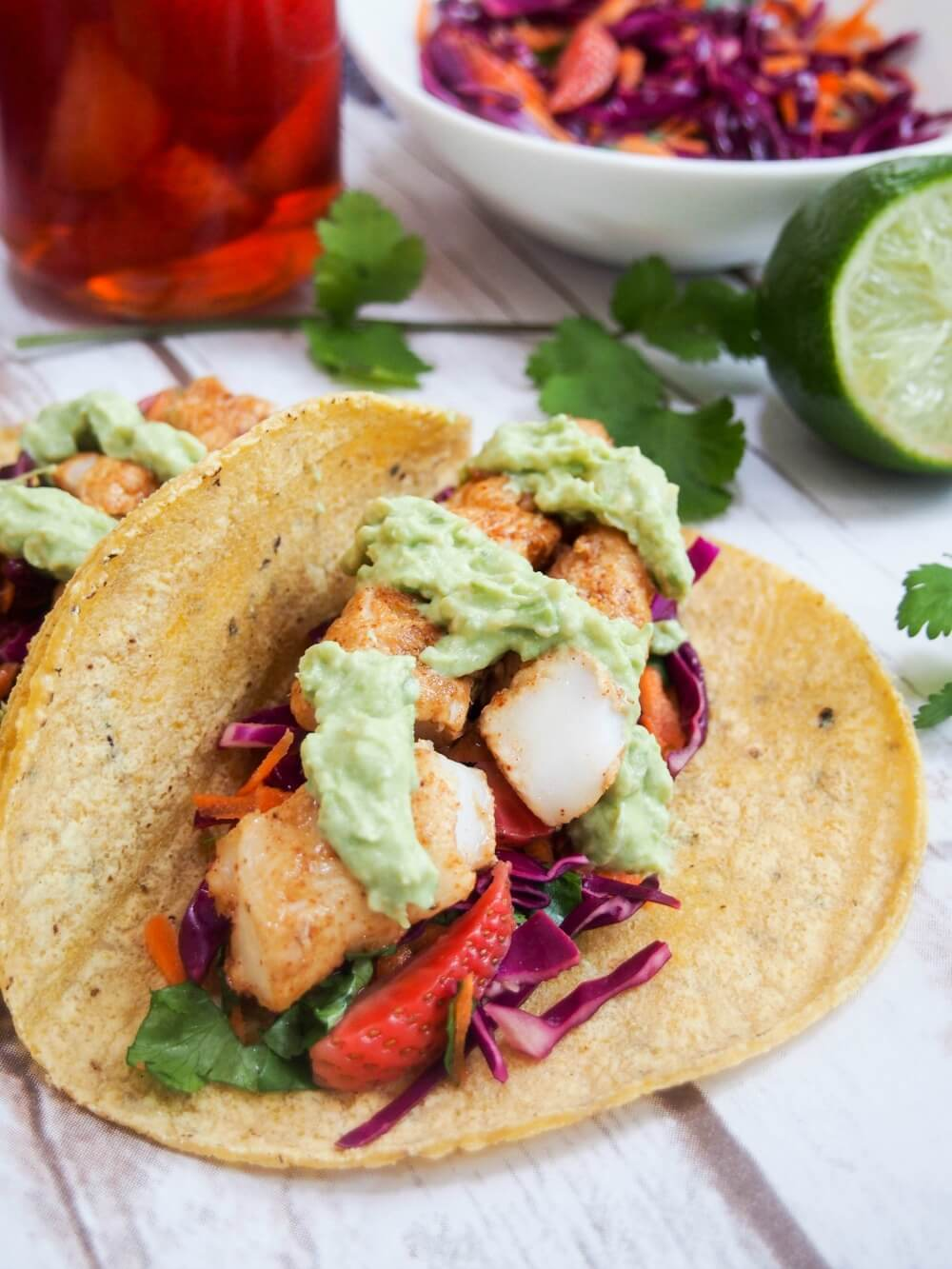 Cod tacos with pickled strawberry slaw with avocado on top