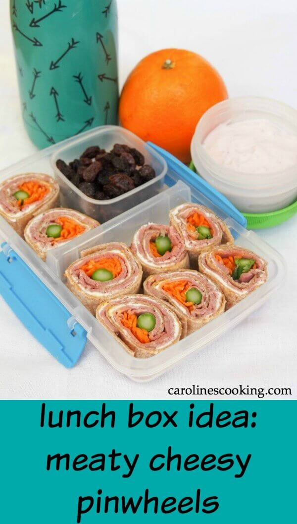 Kids' lunches don't have to be boring and lacking nutrition. These meaty cheesy pinwheels, with a side of fruit and yogurt, are a lunch box idea everyone can love. #ad#pinwheelsandwich #beef #lunchbox #kidslunchbox